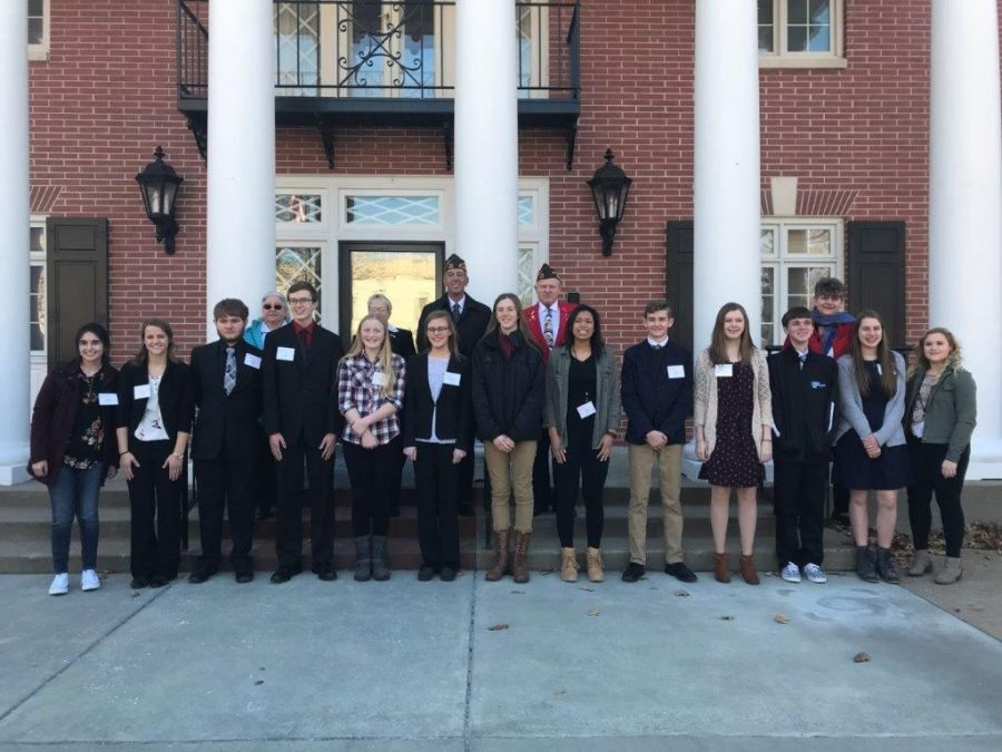 Winners of Patriots Pen and Voice of Democracy Essay Contests with members of the VFW in front of Governors Mansion.