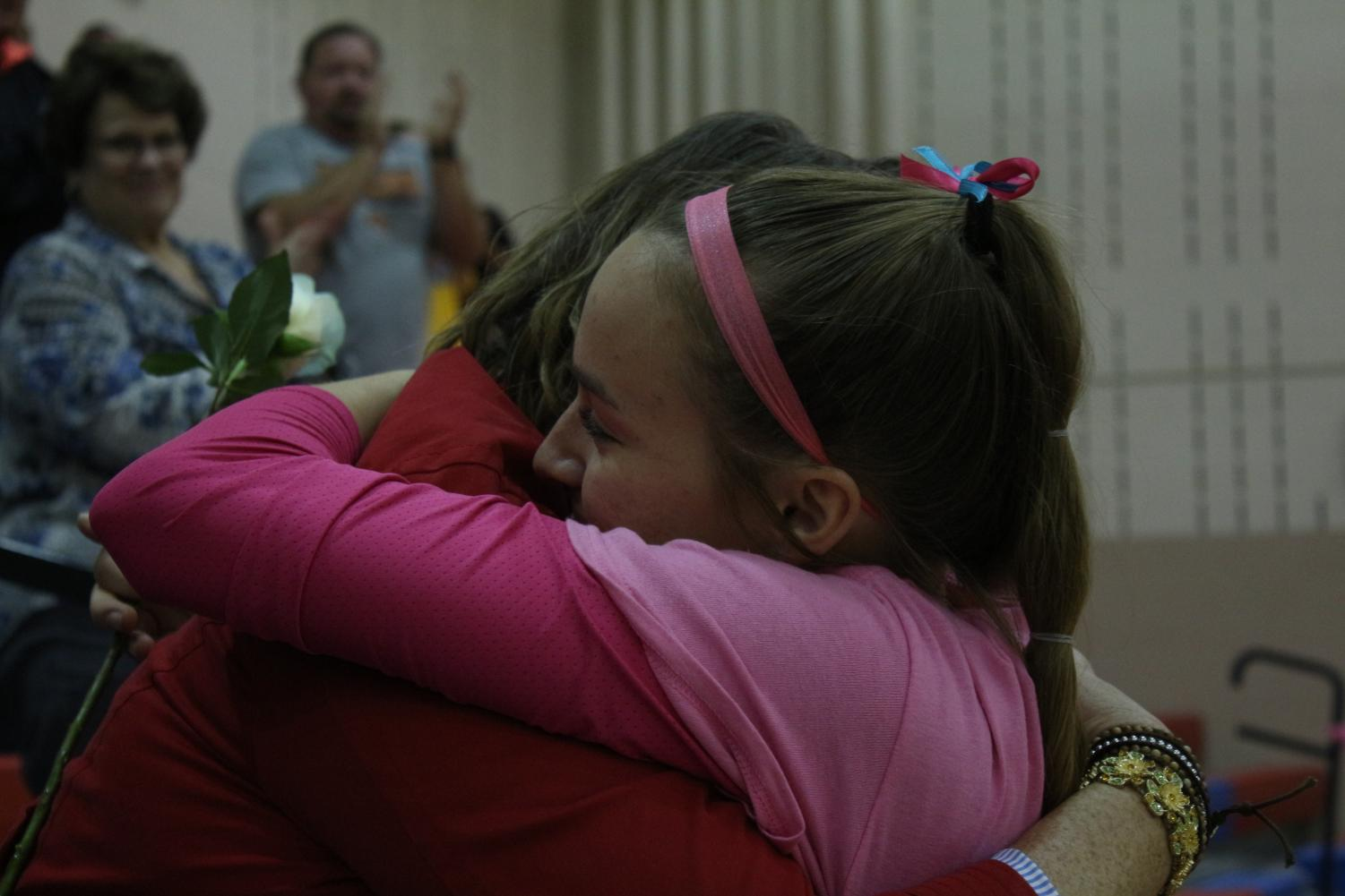 Teri Zanker and her mother share a moment during the Dig Pink Volleyball event.