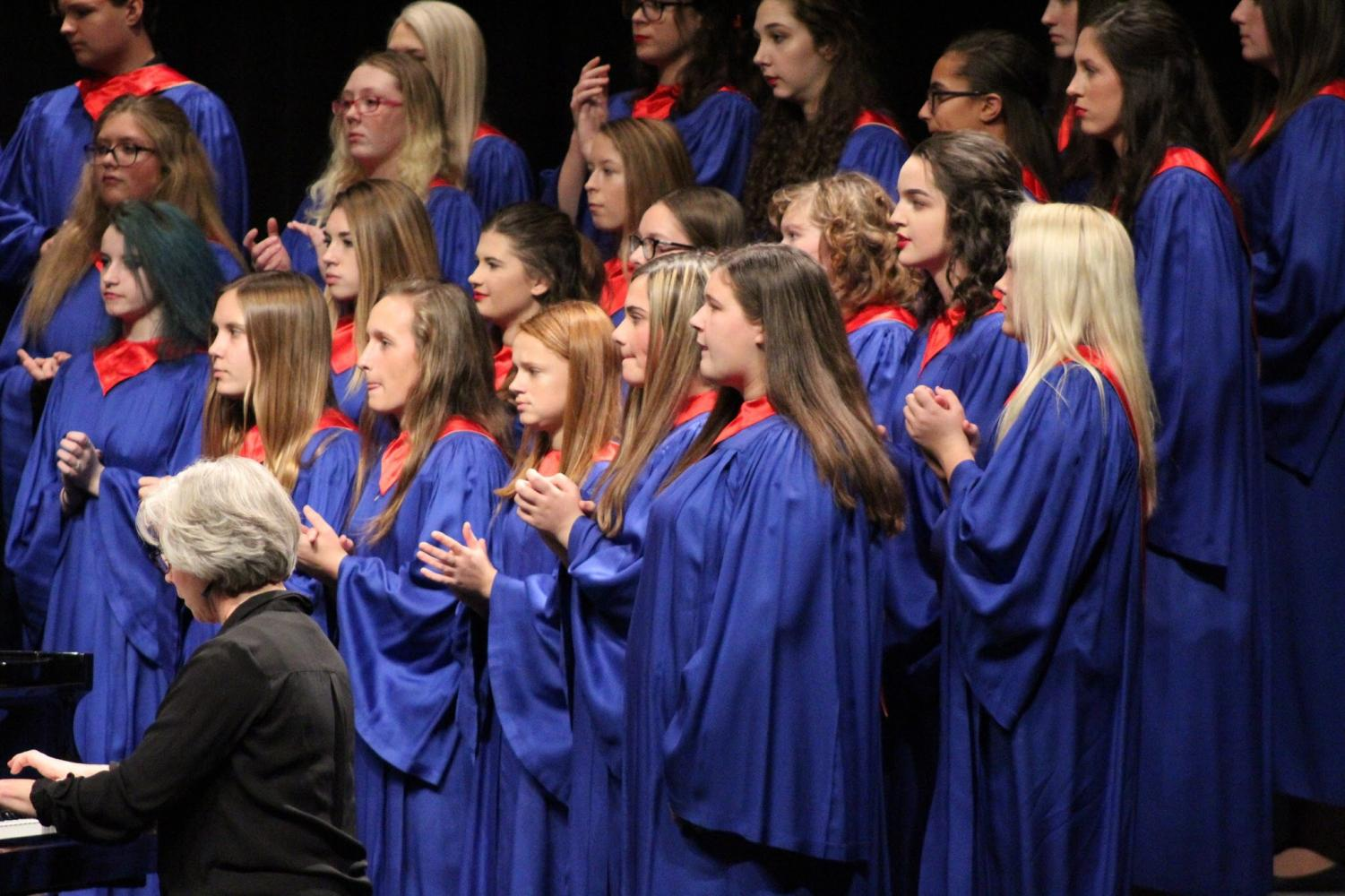 "The choir performed a Spanish song ""Ritmo"" during their first concert. ""Ritmo"" featured a lot of clapping, so the choir focused to be sure they didn't miss a beat."
