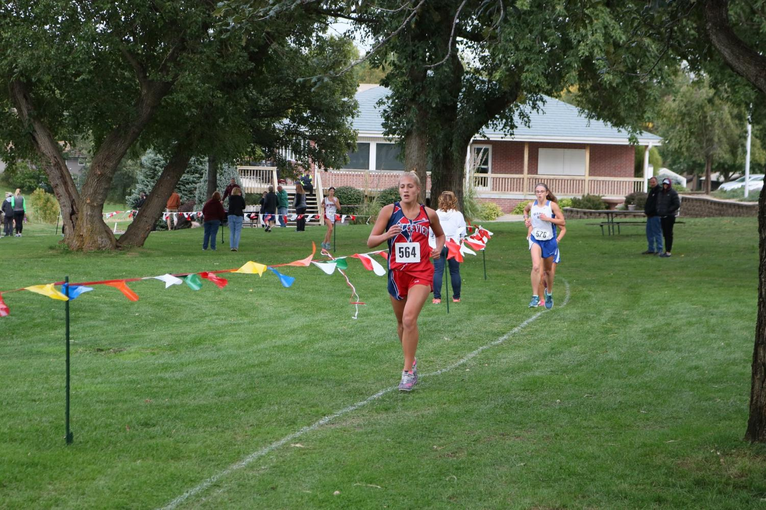 Senior Jacque McCullough ran during the girl's conference meet held in September.