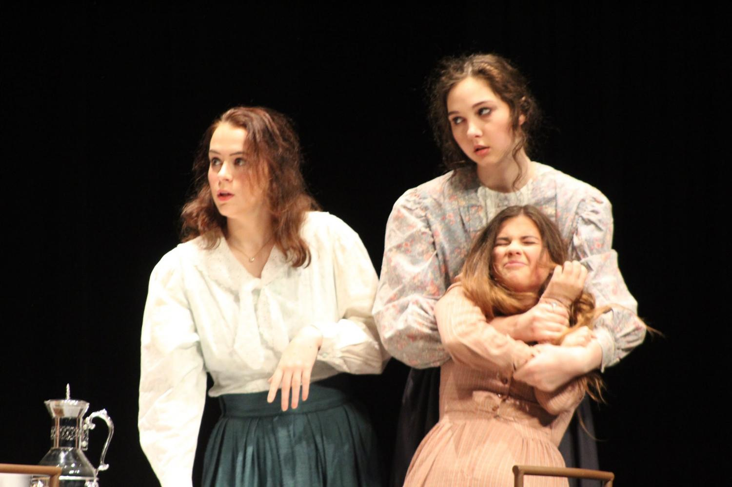 Students Amber Neaman, Katelyn Grubb, and Alyssa Riha acted in a scene together, in which they portrayed Kate Keller, Anne Sullivan, and Helen Keller.