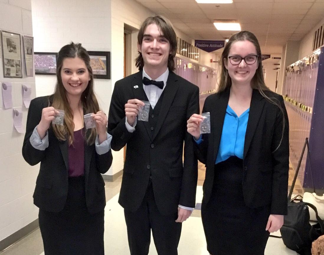 Speech members Alyssa Riha, Louden Ferguson, and Ella Ferguson pose for a photo with their medals.