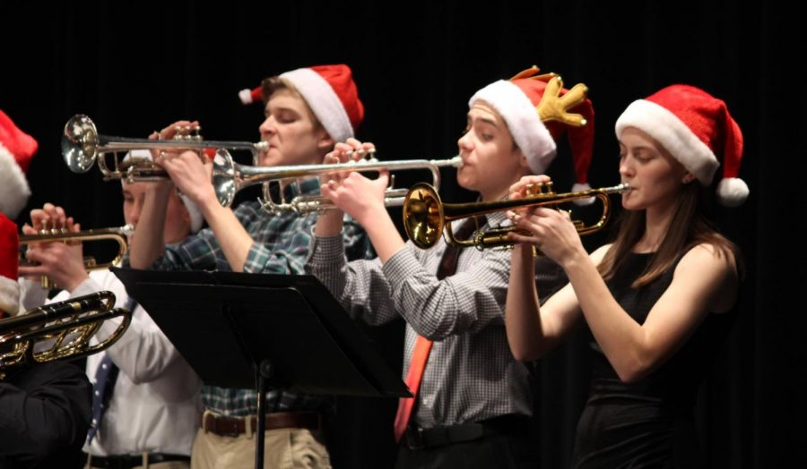Freshman+Charles+Lawrence+and+Ashton+Lagassee+and+Senior+Katelyn+Stehlik+blew+into+their+trumpets+during+the+winter+concert.+They+played+the+classic+song+%E2%80%9CJoy+to+the+World%E2%80%9D+to+the+delight+of+the+audience.+It+was+a+classic+version+of+the+song.