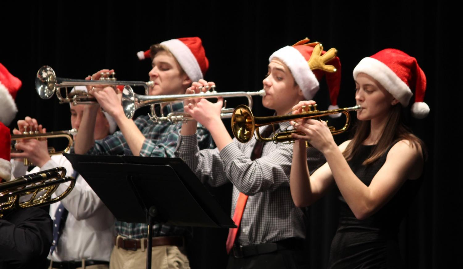 """Freshman Charles Lawrence and Ashton Lagassee and Senior Katelyn Stehlik blew into their trumpets during the winter concert. They played the classic song """"Joy to the World"""" to the delight of the audience. It was a classic version of the song."""
