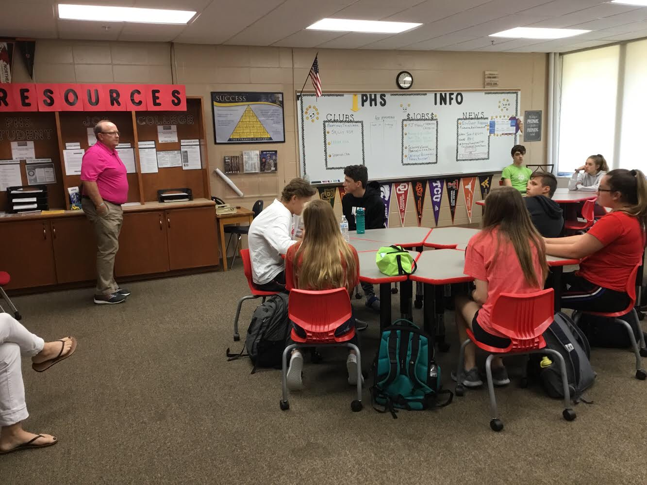 Mr. Jennings explains the resources that are available at the College/Career Center to Mrs. Falch's attentive advisory students.