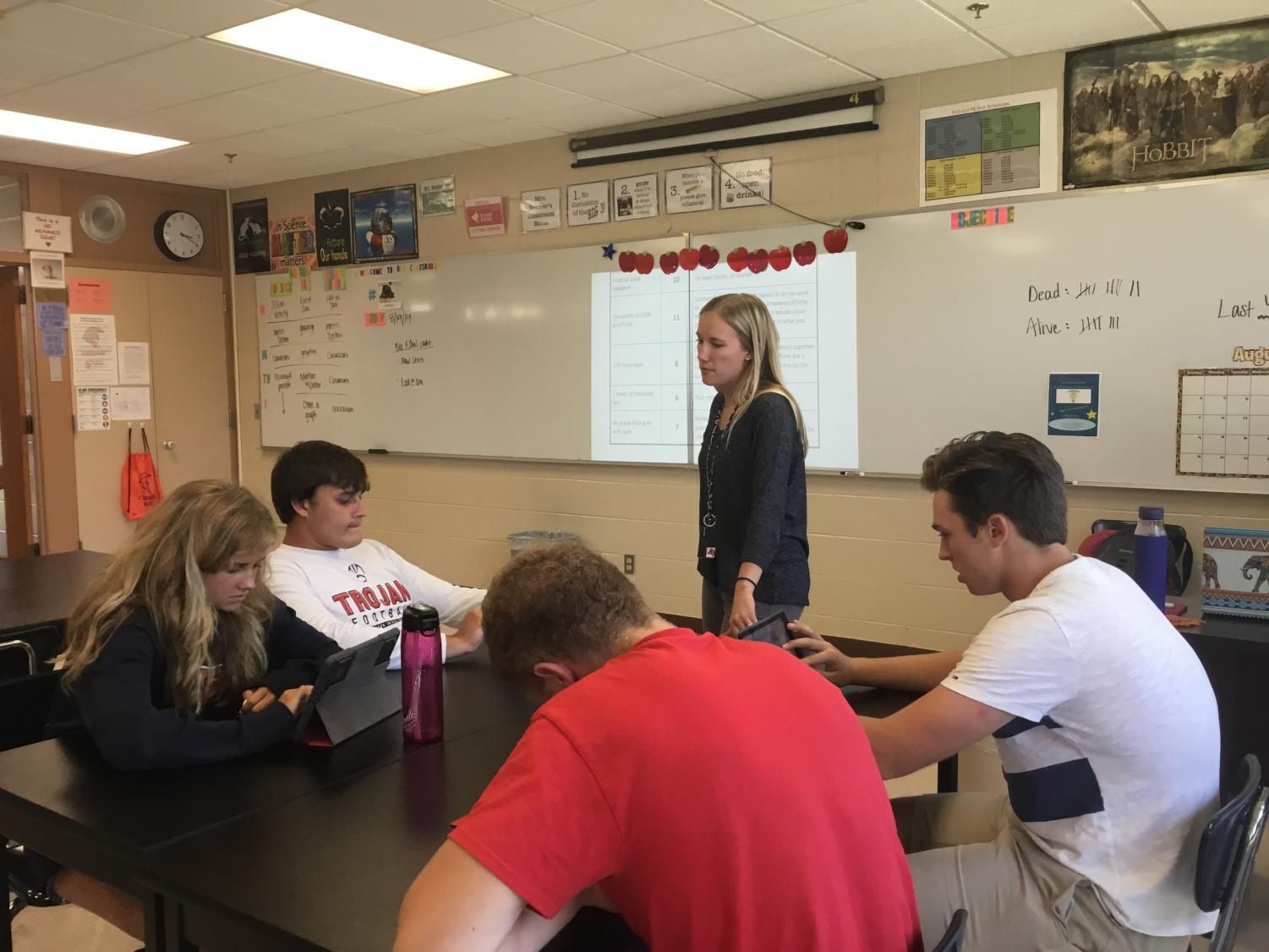 Mrs. Donner interacts with students in her Dual Credit Biology class.