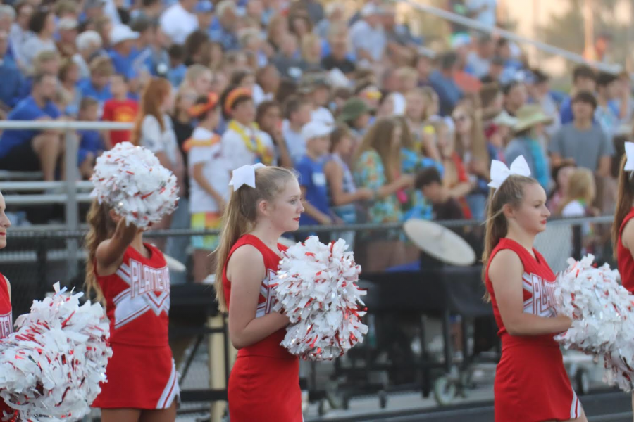Platteview+Cheerleaders%2C+Mary+Houlton+and+Baily+Korenoski%2C+spiriting+at+the+home+football+game+on+September+6th%2C+where+the+Trojans+played+the+Blue+Jays.