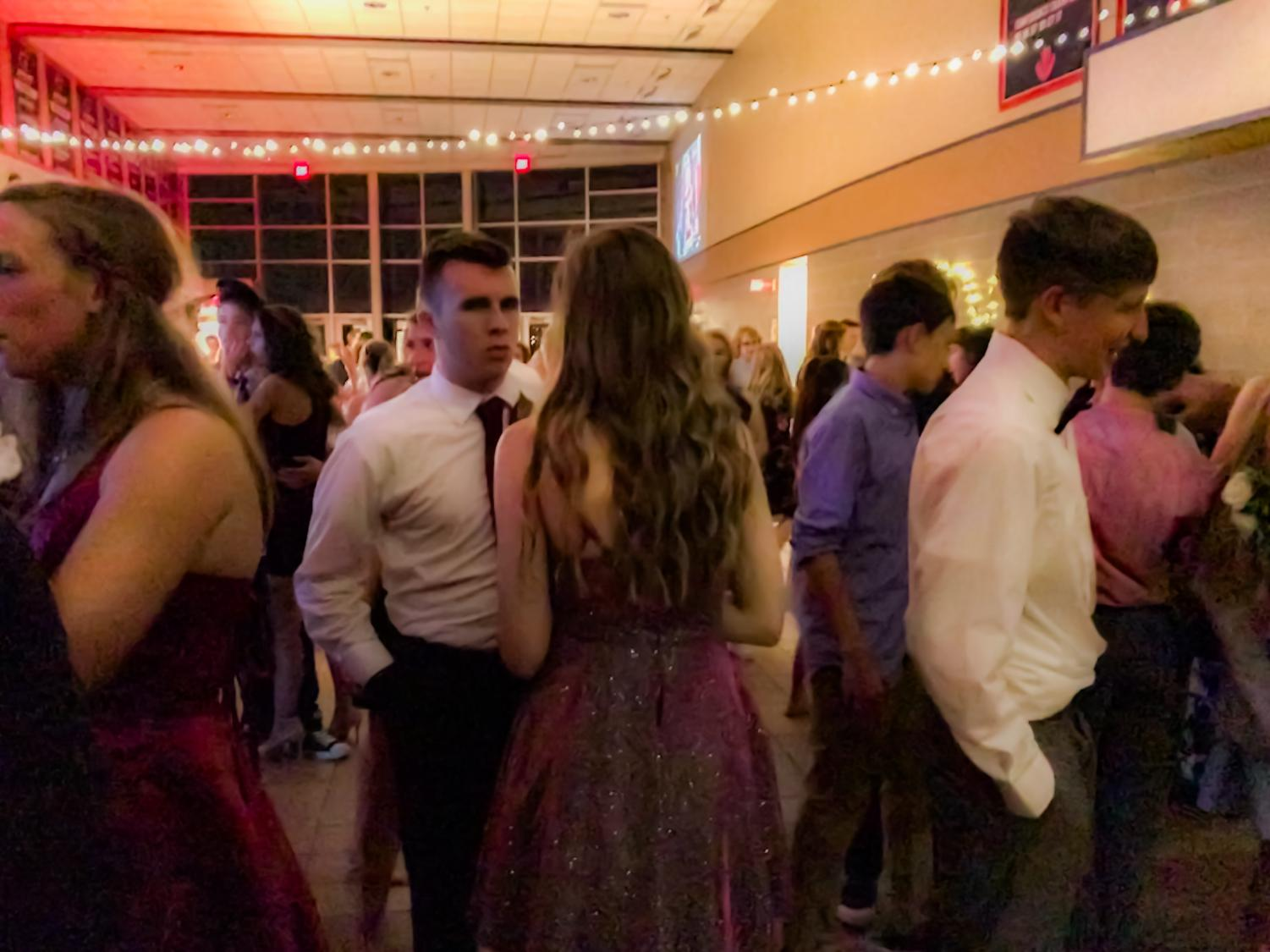 Senior Noah Vanderzwaag converses with his date at the 2019-2020 Homecoming Dance on Saturday, September 14.