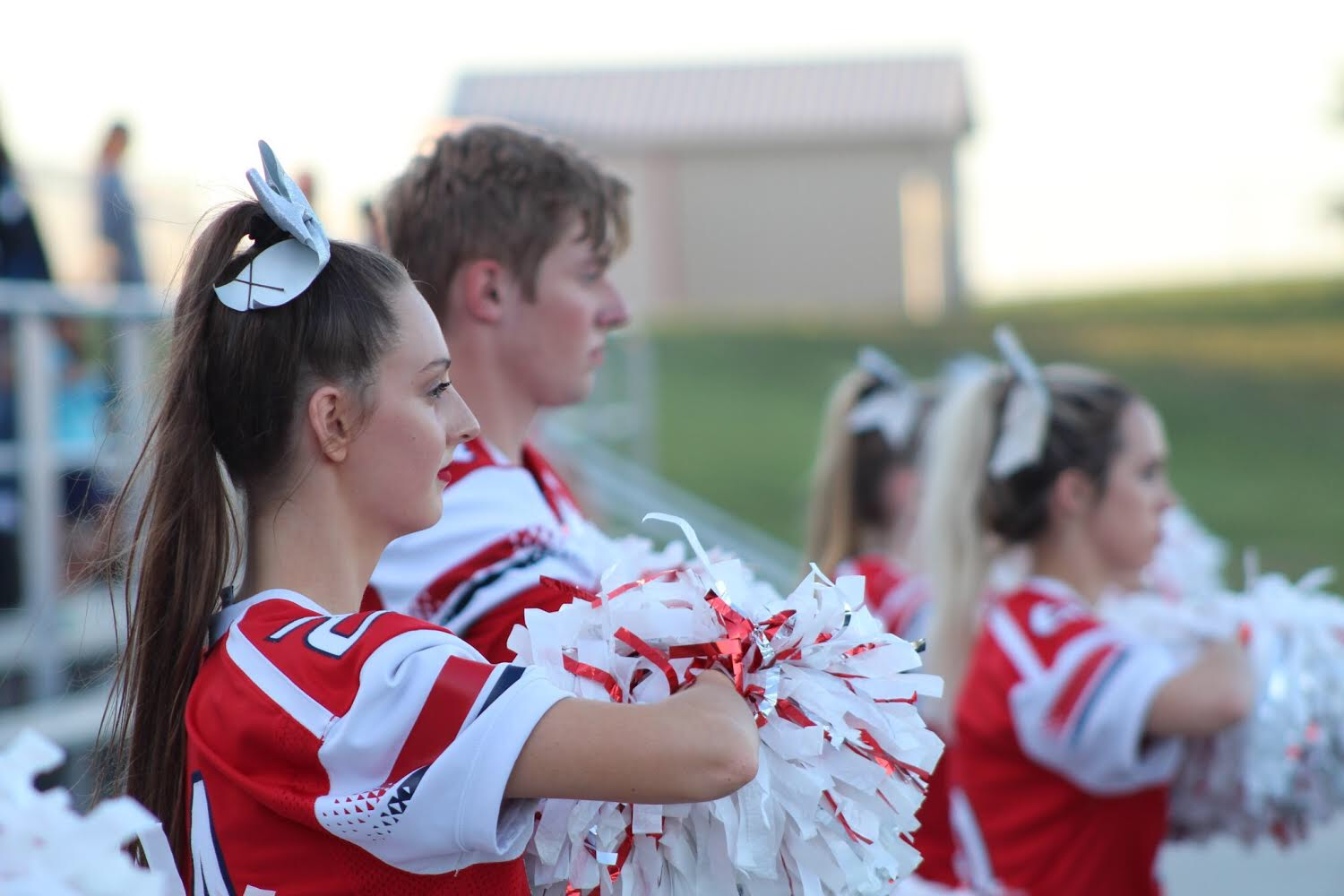 Ella Kiger stands at attention during the playing of the national anthem at the Homecoming football game.