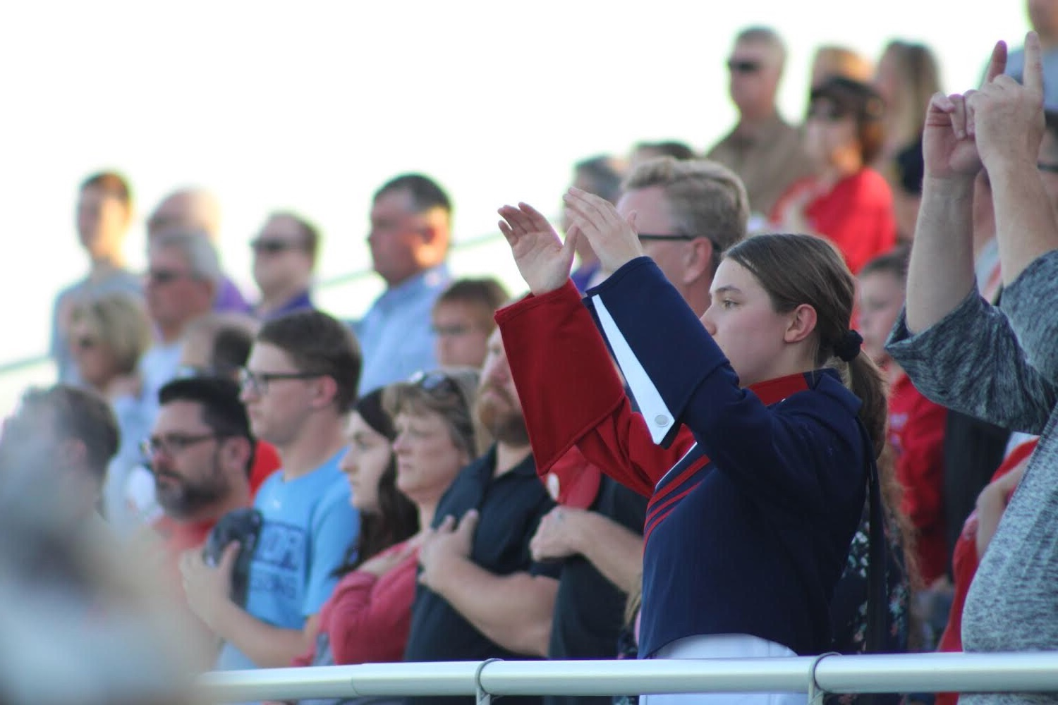 "Drum Major Claire Snodgrass (11) co-directs the band to ""Star Spangled Banner"" at  a Platteview home football game."
