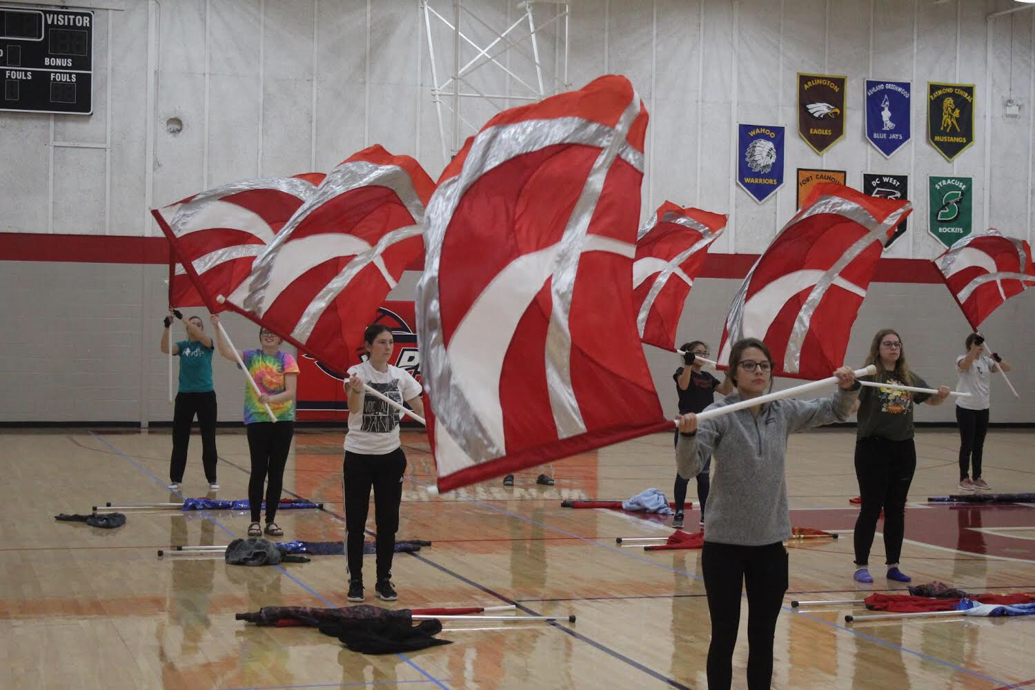 The Color Guard team practiced their routine in the front gym after school shortly before the State Marching Band competition.
