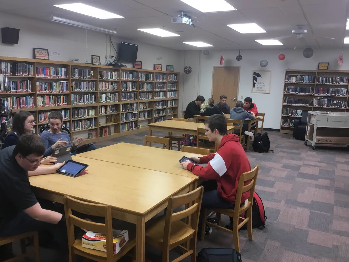 Platteview's two FPS teams, the sophomore group and the junior/senior group, sit together while discussing the problem at hand and enjoying donuts. Most of the group are veterans from last year, but they've expounded their wisdom to the new members.
