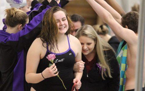 Lauren Beccera celebrates her senior year of swim with her parents.
