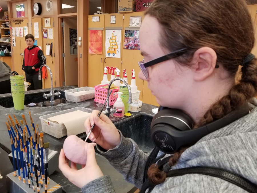 Senior Kiyara Grosz adds detail to her brain sculpture while she is at Art Club. Club members meet every Thursday after school.