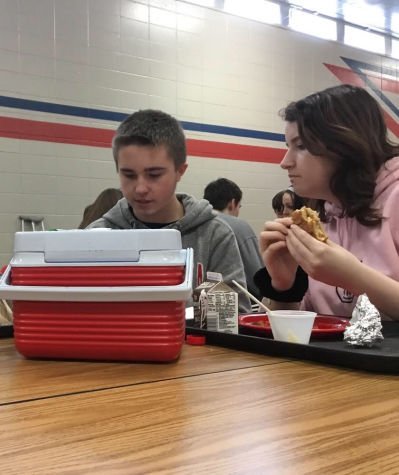 Dakota Huxhold and Justice Irvin adjust to the new lunch schedule as they eat second lunch.