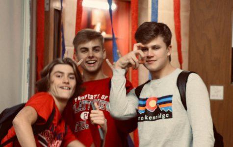 Seniors James Schulze, Colton Pugh, and Garrett Harrah pause for a picture in the hallway.