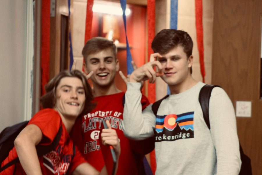 Seniors+James+Schulze%2C+Colton+Pugh%2C+and+Garrett+Harrah+pause+for+a+picture+in+the+hallway.