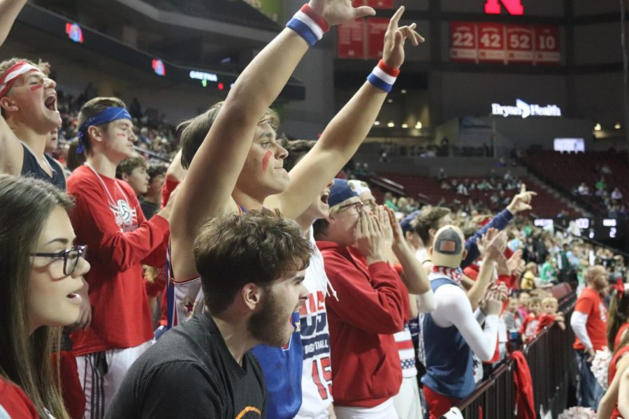"Senior Jace Mahoney cheers during the state volleyball tournament. Through Mahoney's experience at Platteview, he said, ""I have learned that [it] is okay to be interested in a lot. It's okay to be in more than just sports. I also learned to be nice to every single person I interact with because of the community I've grown with."""