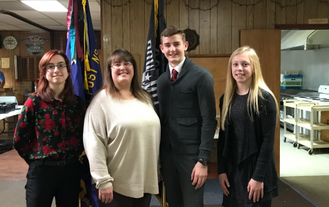 Voice of Democracy winners Brianna Miller (11), Dylan Conover (10),  and Allison Kuhl (11) stand with English teacher Mrs. Janda after the dinner and announcement of the awards.