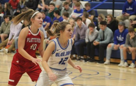 Senior Emma Lewis is seen at the Varsity Girls Basketball game in Ashland-Greenwood against the Bluejays. She keeps her eyes on the ball and her head in the game while passing an opponent.