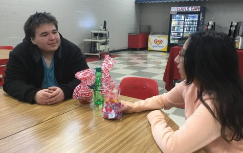 Freshmen Alexander Glynn and Eileen Ramirez discuss the Celebrate Safe valentine gifts during study hall. The gifts will be on sale during lunch if you would like to purchase one for your friend or significant other.