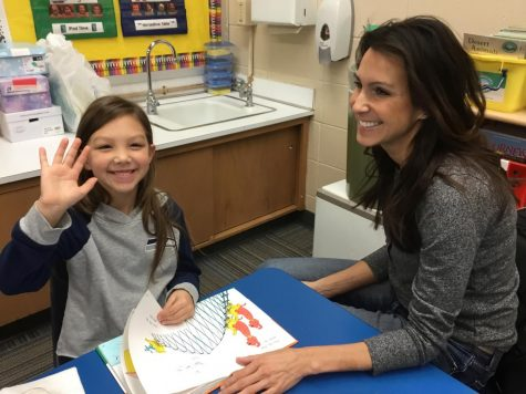 A Springfield Elementary student and her guest enjoy reading together to celebrate Read Across America.