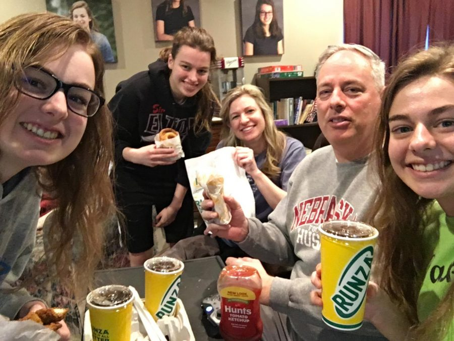 The Hartley family, including sophomore Josephine Hartley (second from left) and senior Grace Harley (right), enjoyed their take-out food from Runza.
