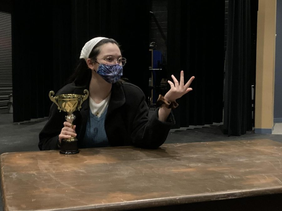 Kyley Bishop (12) rehearses for the upcoming musical, contemplating the value of the coveted spelling bee trophy.