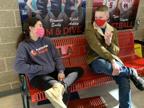New and Hopefully Improved:   Trojans BeKind: Joanna Engel (11) and Mannix Crockett (11) discuss what it means to be a kind Trojan. They share with each other what they learned from guided research and available resources about spreading kindness and positivity.